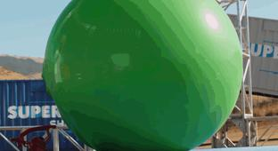 Dude Scientists Stand Inside Giant Balloons As They Slowly Inflate