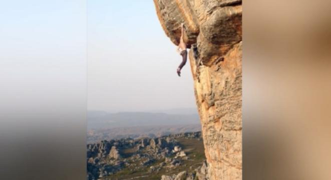 Maniac Hangs Off A Cliff Face One-Handed Without A Harness