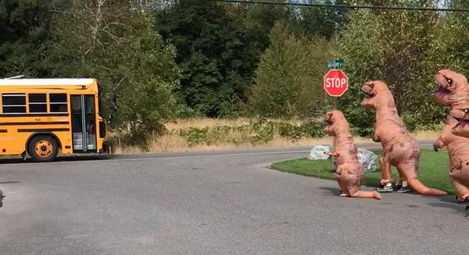 T-Rex Family Waits For Its Human Offspring At The Bus Stop - Digg