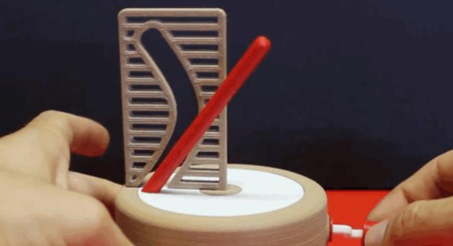 How In The Heck Does This Straight-Pole-Through-A-Curved-Hole Illusion Work?