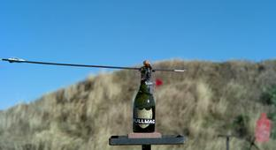 Uncorking Champagne Bottles With Crossbows And A .50 Caliber Rifle