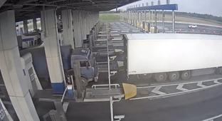 Truck Driver Tries To Sneak Through Under A Toll Booth Arm, Gets Some Instant Karma
