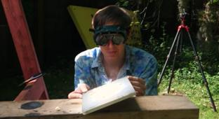 Backyard Scientist Sets Up A Giant Fresnel Lens To Burn Random Objects