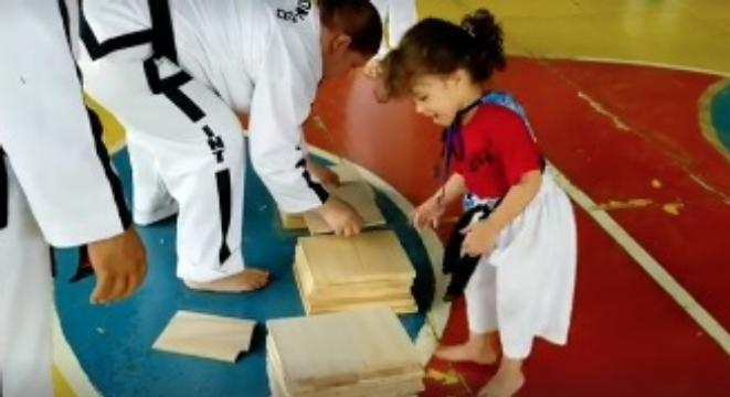 Taekwondo Instructor Tries To Show Little Girl How To Break A Board, And The Girl Takes Her Way Too Literally