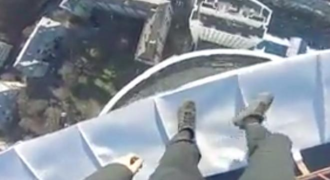 Urban Explorer Perilously Stands On The Very Top Of The Tallest Building In Ukraine