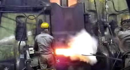 Giant Machines Forging Big Ol' Slabs Of Glowing Hot Metal Is So