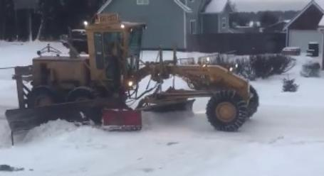Alaskan Snow Plow Has A Clever Method To Keep It From Burying Driveways