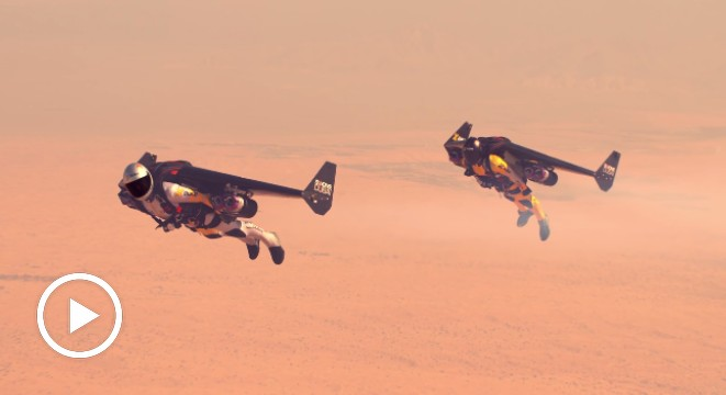 Jetman Flies In Formation With A Stunt Plane, Welcomes The Future