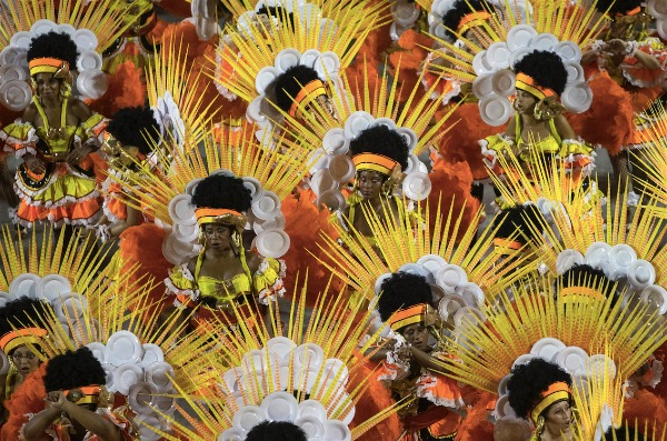 Image: Performers from the Sao Clemente samba school parade during carnival celebrations at the Sambadrome in Rio de Janeiro, Brazil, Monday, March 3, 2014.