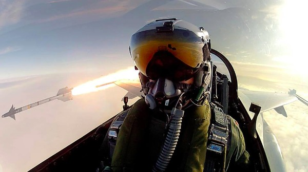 Image: A Royal Danish Air Force F-16 pilot snaps a selfie while firing an AIM-9L/M Sidewinder missile.