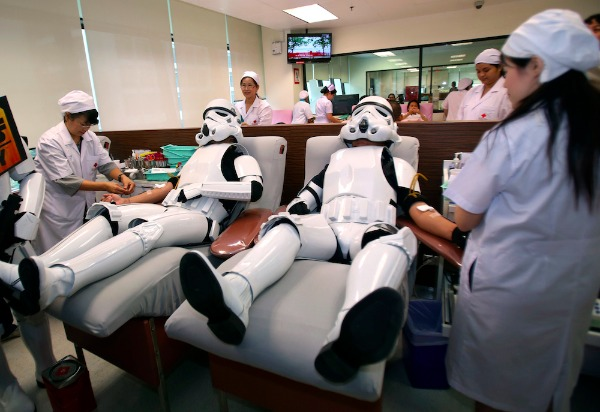 Image: Udomsak Ratanotayo, left, and Suttinan Boonsomkiat wear storm trooper costumes while donating blood at the Thai Red Cross in Bangkok.
