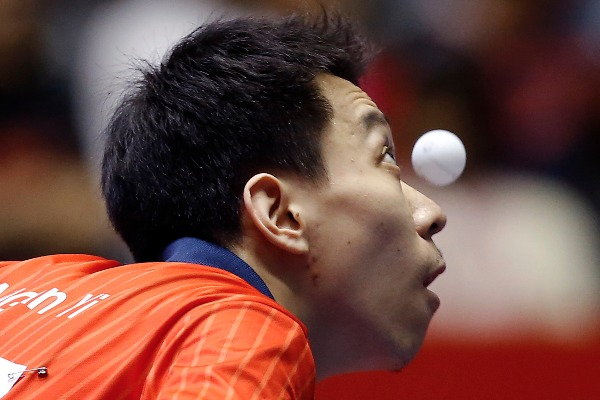 Image: Jiang Tianyi of Hong Kong watches the ball during his round robin match of the World Team Table Tennis Championships against Andrej Gacina of Croatia in Tokyo, Tuesday, April 29, 2014.