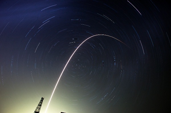 Image: The Soyuz-FG rocket booster with Soyuz TMA-13M space ship carrying a new crew to the International Space Station, ISS, flies in the sky at the Russian leased Baikonur cosmodrome, Kazakhstan, Thursday, May 29, 2014. Circular star tracks around the Polar Star and track of the rocket a the result of the long time exposure.