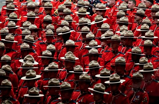 Image: RCMP officers attend the funeral procession for slain Royal Canadian Mounted Police Constable David Wynn, in St. Albert, Alta., on Monday, Jan. 26, 2015. Wynn died four days after he and Auxiliary Constable Derek Bond were shot by Shawn Rehn in St. Albert, Alta, on Saturday, Jan. 17, 2015.