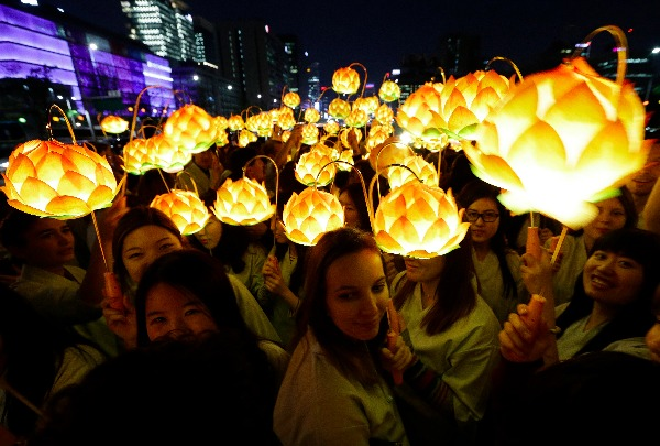 Image: Buddhist believers holding lanterns in the shape of lotus flowers walk around the Gwanghwamun Plaza in Seoul, South Korea, on Wednesday, April 29, 2015, to celebrate Buddha's upcoming birthday, which is on May 25.