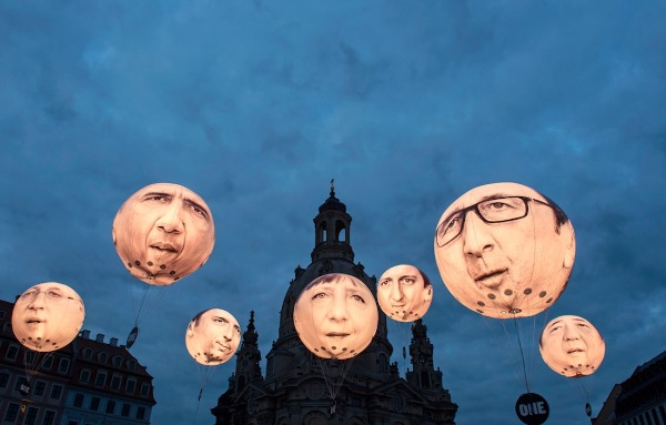 Image: Activists of the international campaigning and advocacy organization ONE install illuminated balloons with portraits of the G7 heads of state in front of the Frauenkirche cathedral (Church of Our Lady) prior the G7 Finance Ministers meeting in Dresden, eastern Germany, Wednesday, May 27, 2015. The G7 Finance Ministers meeting is to be held in Dresden from May 27 to May 29, 2015.