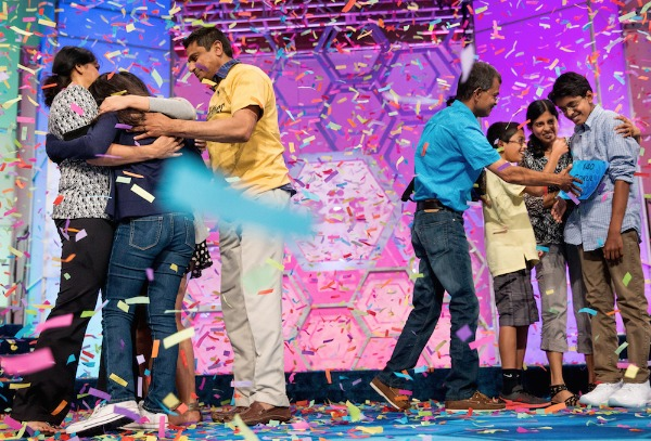 Image: Vanya Shivashankar, second from left, 13, of Olathe, Kan., and Gokul Venkatachalam, right, 14, of St. Louis, are greeted onstage by their families as co-champions after winning the finals of the Scripps National Spelling Bee, Thursday, May 28, 2015, in Oxon Hill, Md.