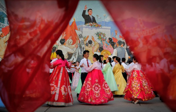 Image: Students participate in a mass dance in front of a mural of the late North Korean leader Kim Il Sung delivering a speech, Monday, July 27, 2015, in Pyongyang, North Korea as part of celebrations for the 62nd anniversary of the armistice that ended the Korean War.