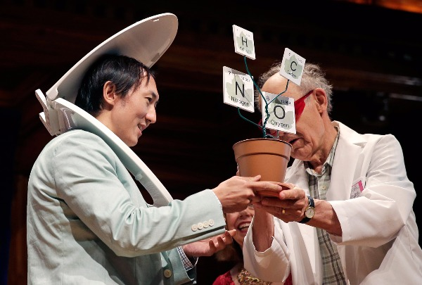 Image: While wearing a toilet seat on his head, David Hu accepts the Physics Prize, for his research on the principle that mammals empty their bladders of urine in about 21 seconds, from Dudley Herschbach, right, the 1986 Nobel Laureate in Chemistry, while being honored during a performance at the Ig Nobel Prize ceremony at Harvard University, in Cambridge, Mass., Thursday, Sept. 17, 2015.