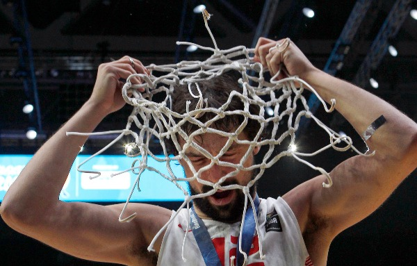 Image: Spain' s Sergio Llull uses the net as a hat after winning the Eurobasket European Championship final between Spain and Lithuania in Lille, northern France, Sunday, Sept. 20, 2015. Spain beats Lithuania 80-63 to take Eurobasket gold medal.