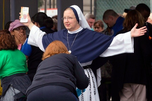 Image: A nun from The Sisters of Life, of New York City, is inspected at a security checkpoint as she arrives for a Mass to be celebrated by Pope Francis, Sunday, Sept. 27, 2015, in Philadelphia. Pope Francis will end the final day of his three-city U.S. tour with the Mass on Philadelphia's grandest boulevard, the Benjamin Franklin Parkway.​