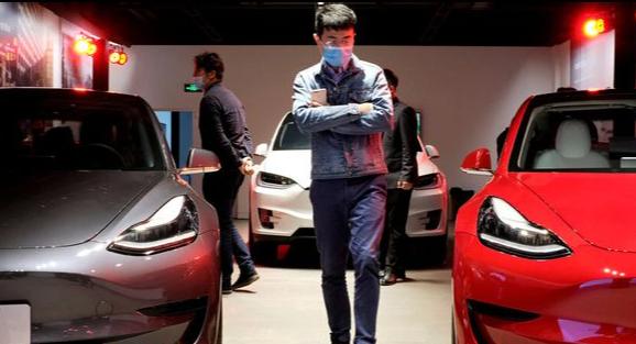 Tesla's Stock Tumbles Amid Sales Worries And Market Volatility