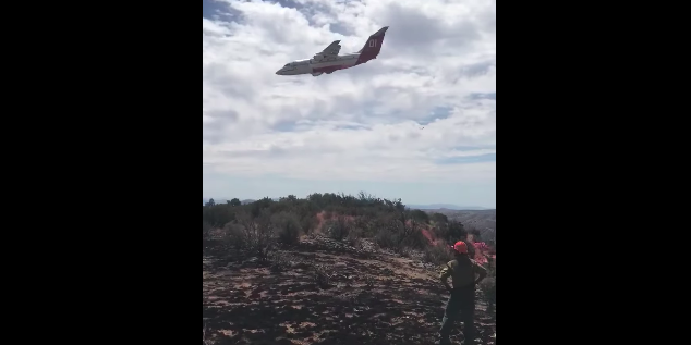 Fire Fighting Plane Pilot Is Too Focused On Putting Out Fire, Almost Crashes Into Mountain