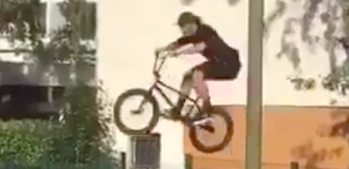 BMX Bike Rider's Amazing Reflexes Saves Him After Botched Jump Over Fence