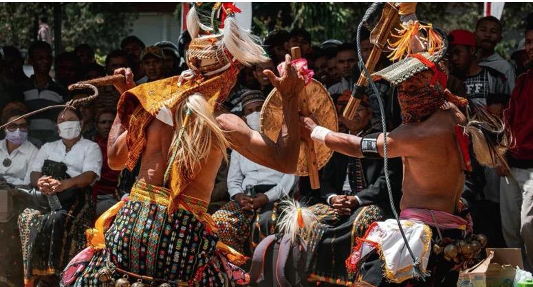 Indonesia's Manggarai Warrior Caci Whip Fights, In Photos