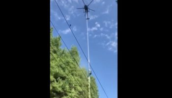 Who Signed Off On This Helicopter Trimming Trees Near Live Power Lines?