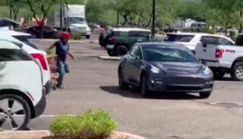 Guy Chases Down Tesla, Not Knowing The Car Was Being Summoned