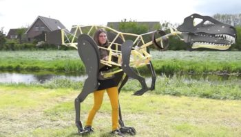 Watch This Artist Test Out A Prototype Of Her Full-Body Velociraptor Costume