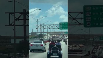 Maniac Rides A Golf Cart On The Highway In Miami