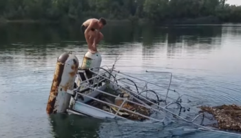 Man Hilariously Sticks To A Sinking Pontoon Ship To The Very End
