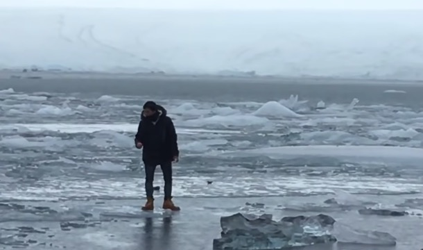 Tourist In Iceland Ignores 'Don't Walk On The Ice' Signs, Starts Floating Away On A Chunk Of Ice - Digg