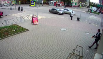 Woman Narrowly Dodges Out Of Control Car That Crashes Into Town Square