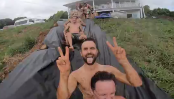 This Group Of Men Thought It Was A Good Idea To Go Down A Gigantic Slide Together. It Really Wasn't