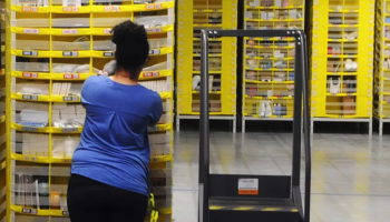 Robots Aren't Taking Warehouse Employees' Jobs. They're Making Their Work Harder.