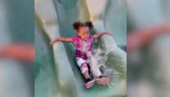 Little Girl Is Absolutely Shocked When She Slides Through A Puddle Of Water