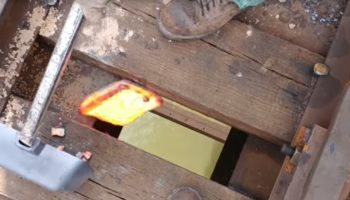 Guy Demonstrates The Surprisingly Powerful Reaction You Get When You Drop Hot Slag Into A River