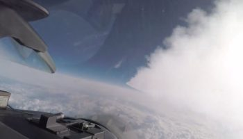 Watch This Tulsa F-16 Fly Through Another Fighter Jet's Contrails