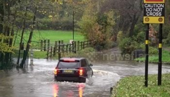 Indecisive Driver Unsure Whether To Drive Range Rover Through Flooded Street