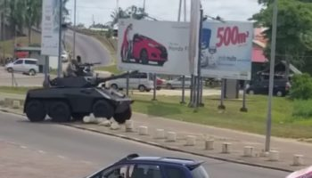 Military Armored Car Massively Misjudges Its Speed, Careens Into A House
