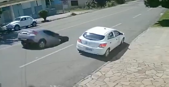 Dump Truck Inadvertently Creates A Sink Hole And A Car Drives Right Into It
