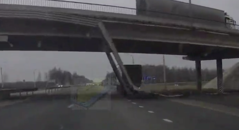 Structure Falls From Overpass, Truck Driver Nearly Smashes Straight Into It
