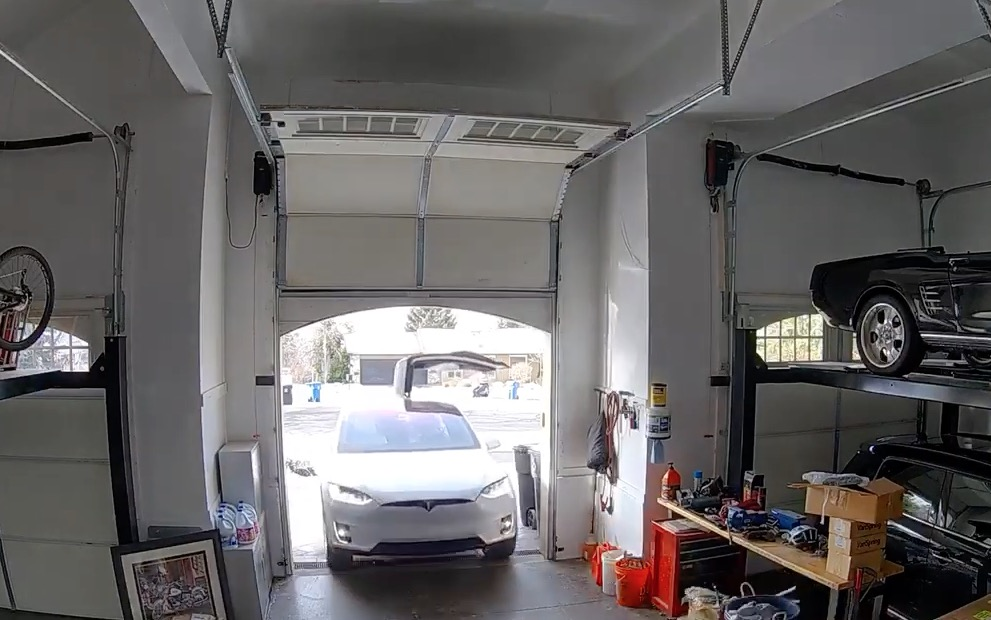 Woman Accidentally Leaves Tesla Model X Gullwing Door Open And Realizes Too Late She Made A Terrible Mistake