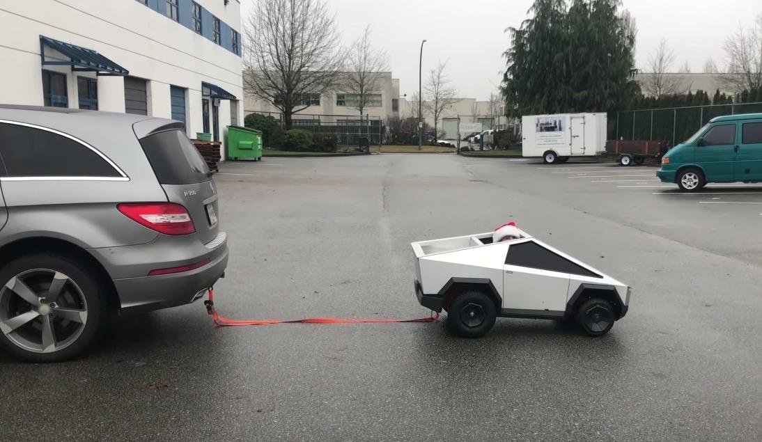 Homemade Mini Tesla Cybertruck Tows A Full-Sized Mercedes