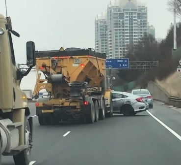 Giant Salt Truck Spotted Pushing Car Helplessly Down Toronto Highway In Surreal Video