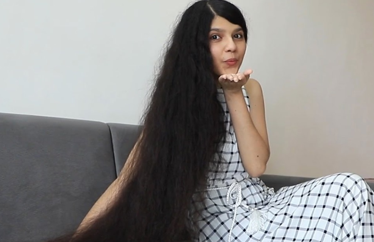 This Woman Has The Longest Hair In The World — What's It Like To Live Like That?