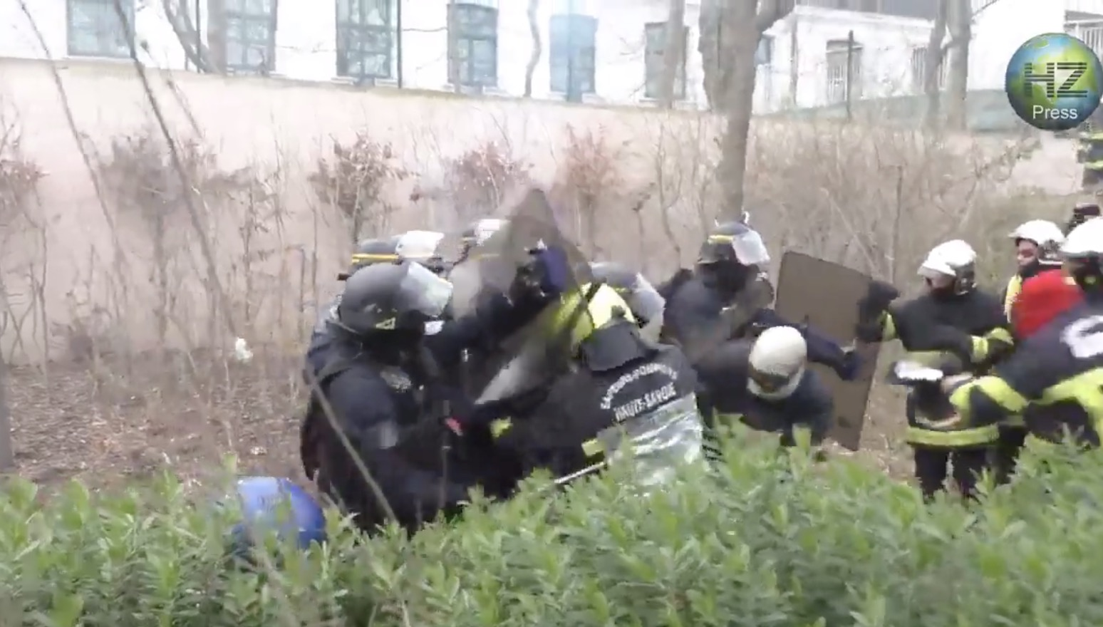 Insane Footage Of Riot Police Charging — And Getting Beaten Back By — Firefighters During Paris Protests